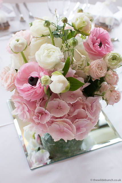Wedding table centre using pinks