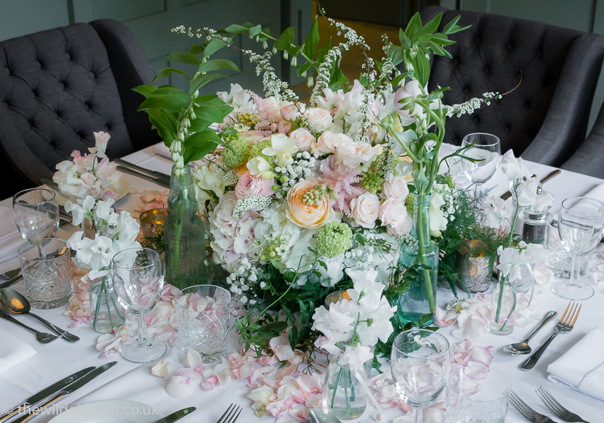 Pastel wedding flowers table centrepiece