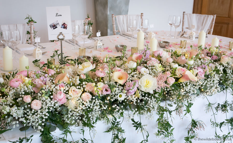 top table wedding flowers at Coombe Lodge